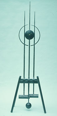 sculptural kinetic clock in forged metal, a contemporary design with movement, a grandfather clock size