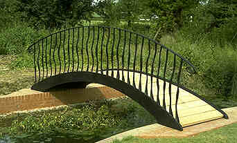 garden bridge over a stream in a Worcestershire garden