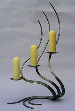 candlestick in forged metal made by blacksmith Paul Margetts