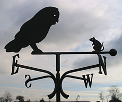 weather vane with owl for a barn