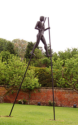sculpture of stiltman for gardens and parks