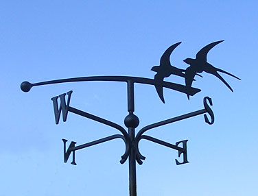 weather vane with birds