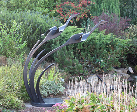 contemporary sculpture of flying swans, bird sculpture, swan sculpture, sculpture of birds, flying geese, garden sculpture, metal sculpture, sculpture for gardens, pool sculpture