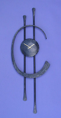 wall hanging clock in metal