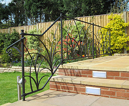 garden railings in wrought iron with butterflies